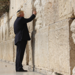 President Donald Trump places a prayer in-between the stone blocks of the Western Wall in Jerusalem, Monday, May 22, 2017. (Official White House Photo by Dan Hansen)