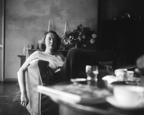 Photograph of Mary Oliver sitting at a table in her home, Pembroke Lodge, Richmond [1930s] Eileen Agar 1899-1991 Presented to Tate Archive by Eileen Agar in 1989 and transferred from the photograph collection in 2012. http://www.tate.org.uk/art/archive/TGA-8927-12-215-1
