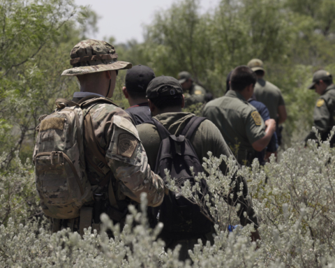 Four illegal aliens apprehended in dense brush by members of the U.S. Border Patrol Search, Trauma, and Rescue (BORSTAR) team are led to awaiting vehicles near Eagle Pass, Texas, June 19, 2019. As Border Patrol agents are tasked to conduct intake and processing of the recent surge in migrant arrivals at the border, members of BORSTAR have been assisting in pursuing illegal aliens afield. CBP photo by Glenn Fawcett