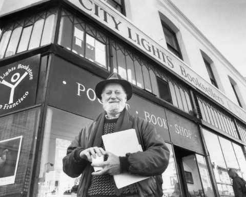 Poet Lawrence Ferlinghetti poses on Monday, Jan. 15, 1988 in San Francisco in front of the North Beach bookstore he founded more than 35 years ago. The San Francisco Board of Supervisors accepted 13 of Ferlinghetti's recommendations on Thursday to change local street names after 15 of San Francisco's best known artists and writers. (AP Photo)