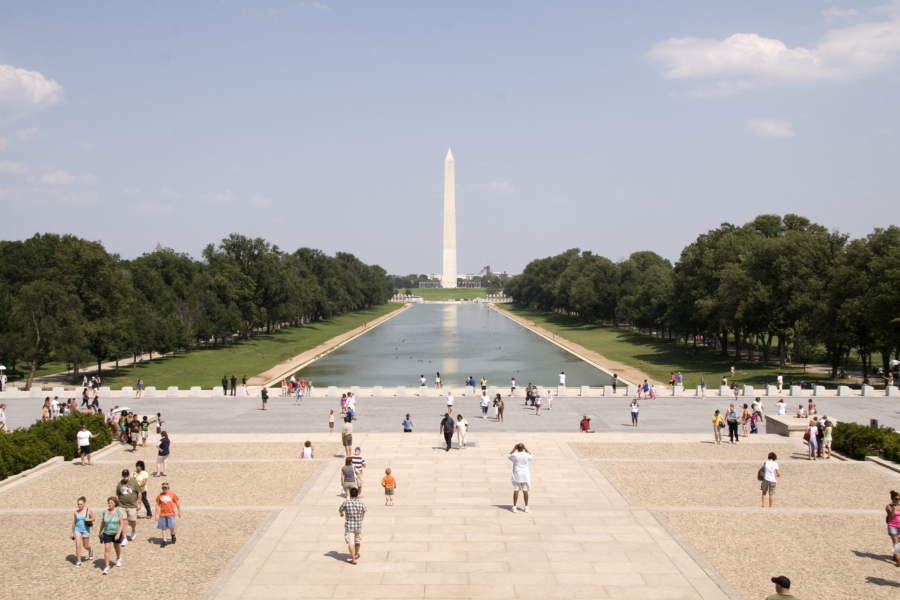 A sun-drenched image of the Reflecting Pool and the National Monument in Washington, DC