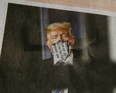 An photograph of Donald Trump in the newspaper, except his mouth has been ripped off.