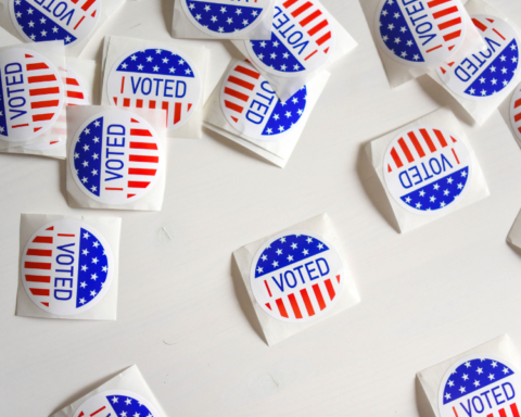 "Photo of many colorful stickers that say ""I Voted"""
