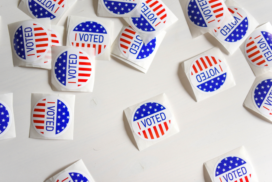 """Photo of many colorful stickers that say """"I Voted"""""""