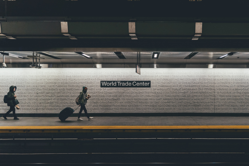 Two people walk through the New York City subway, at the World Trade Center stop.