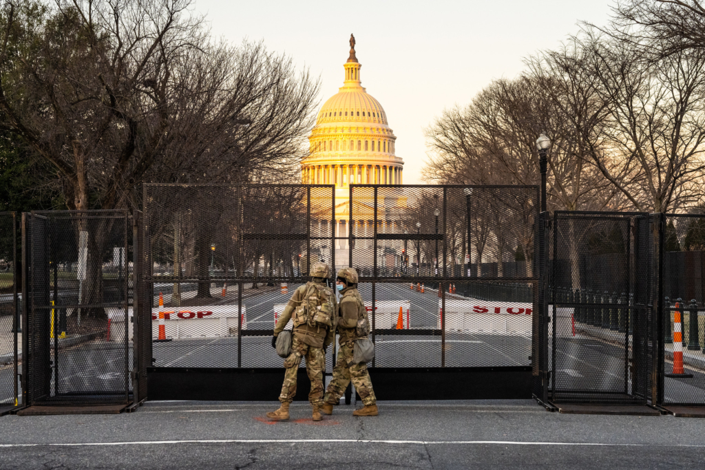 Two members of the National Guard stand outside the U.S. Capitol before the Inauguration of Joe Biden.