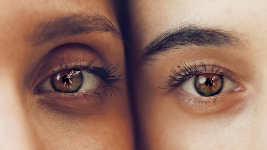 The eyes of two women of color look out.