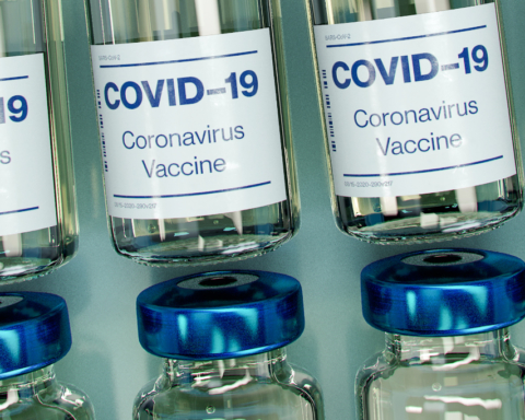 "A photo of glass vials labeled ""Covid-19 Vaccine"""