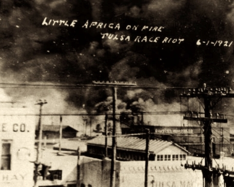 A photo of the fi. Text reads 'Little Africa on fire. Tulsa Race Riot, June 1st, 1921'
