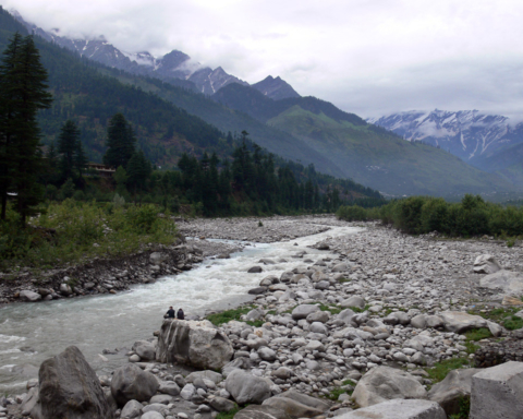 A photo of the River Beas and surrounding mountains.